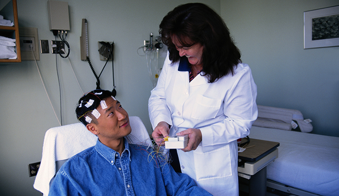 man having brain waves tested