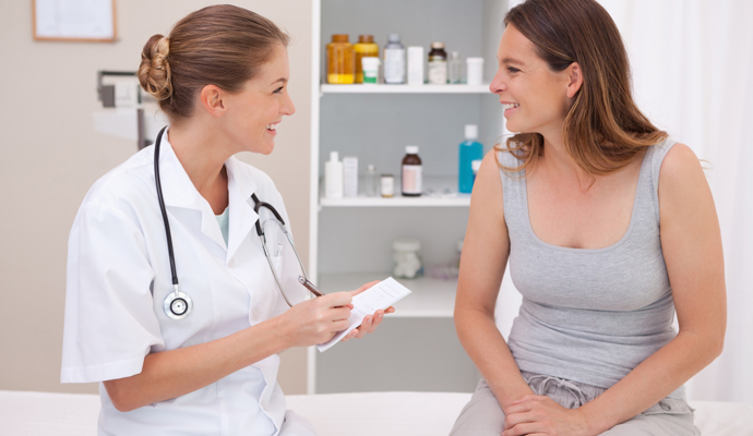 Female doctor and patient discussing care