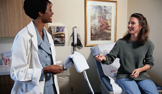woman preparing for a gynecological exam