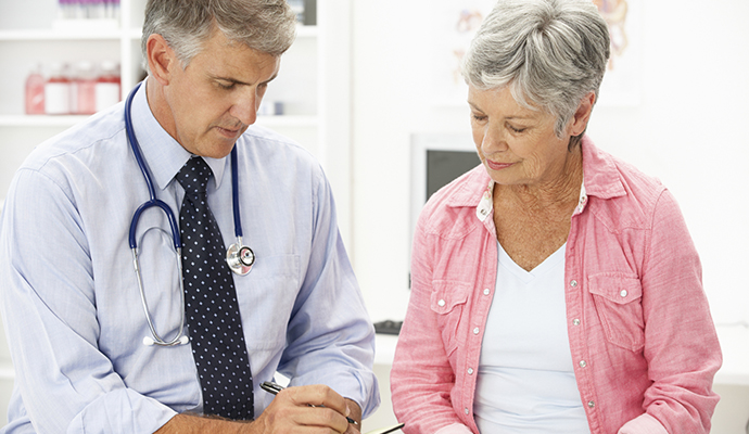 older woman and doctor