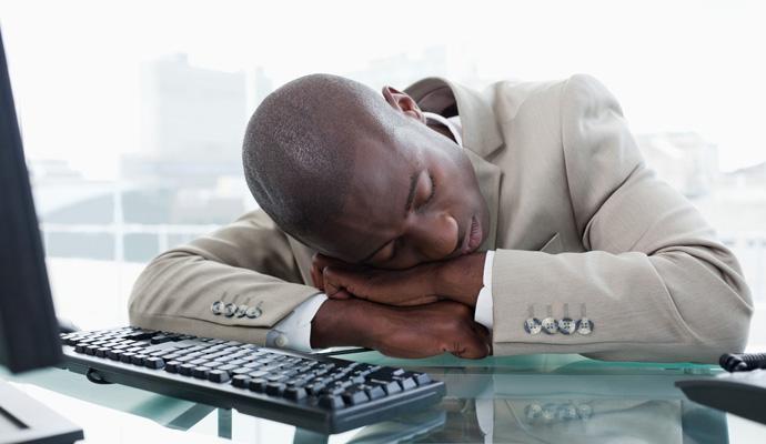man asleep at his desk